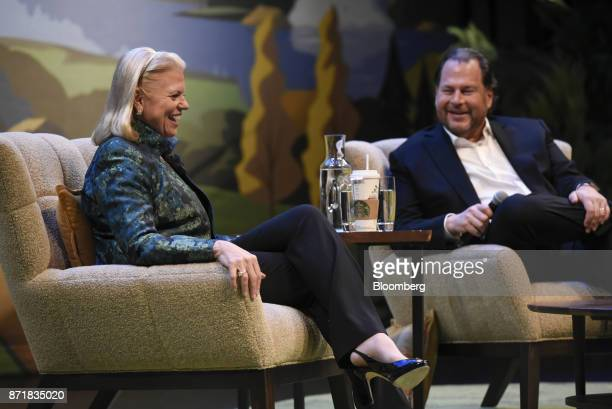 Ginni Rometty chief executive officer of International Business Machines Corp left laughs as Marc Benioff chairman and chief executive officer of...