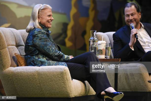 Ginni Rometty chief executive officer of International Business Machines Corp left smiles as Marc Benioff chairman and chief executive officer of...