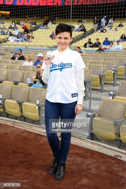 Ginnifer Goodwin attends pre game ceremonies at a baseball game between the Colorado Rockies and the Los Angeles Dodgers at Dodger Stadium on May 1...
