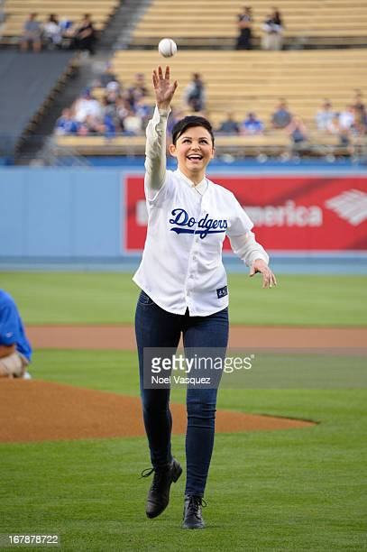 Ginnifer Goodwin throws the ceremonial first pitch at a baseball game between the Colorado Rockies and the Los Angeles Dodgers at Dodger Stadium on...