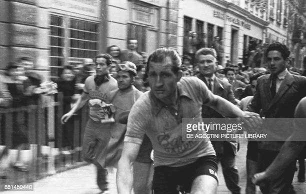 Gino Bartali shortly after cutting the finish line as winner at the MilanSanremo cycling race March 18 Sanremo Italy 20th century