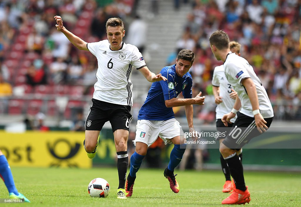 Gino Fechner of Germany (L) is challenged by Paolo Ghiglione of Italy during the UEFA Under19 European Championship match between U19 Germany and U19 Italy at Mercedes-Benz Arena on July 11, 2016 in Stuttgart, Germany.