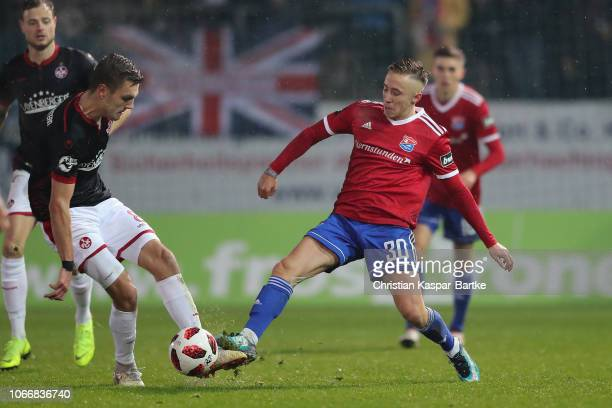 Gino Fechner of Kaiserslautern challenges Luca Marseiler of SpVgg Unterhaching during the 3 Liga match between SpVgg Unterhaching and 1 FC...