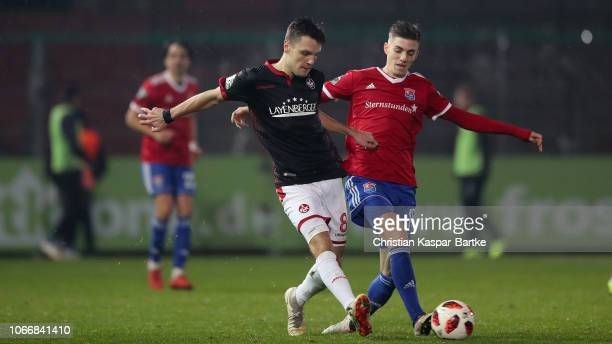 Gino Fechner of Kaiserslautern challenges Lucas Hufnagel of SpVgg Unterhaching during the 3 Liga match between SpVgg Unterhaching and 1 FC...
