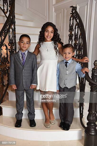 Gino Gorga Antonia Gorga and Joey Gorga Jr pose at home before Gino Gorga's First Communion on May 21 2016 in Montville New Jersey