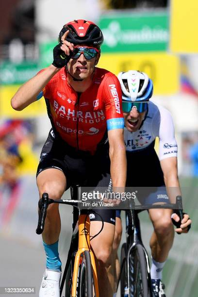Gino Mäder of Switzerland and Team Bahrain Victorious stage winner celebrates at arrival & Michael Woods of Canada and Team Israel Start-Up Nation...