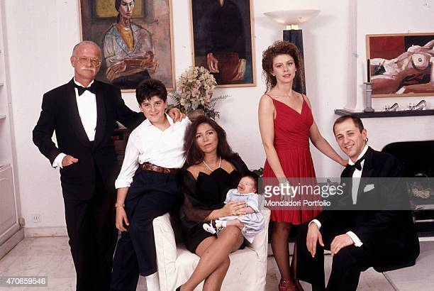 """""""Gino Paoli taken in his home a few days after the birth of his last child, the fourth; the songwriter, dressed in a tuxedo, is in a living room with..."""
