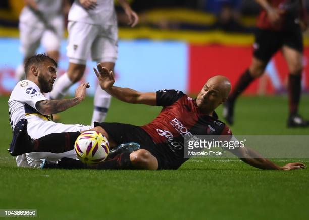Gino Peruzzi of Boca Juniors fights for the ball with Matias Fritzler of Colon during a match between Boca Juniors and Colon as part of Superliga...