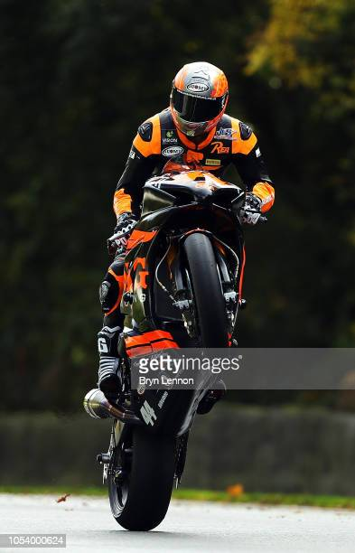 Gino Rea of Great Britain and Suzuki OMG Racing UK LTD pulls a wheelie during free practice 1 at the British Superbike Championship at Brands Hatch...
