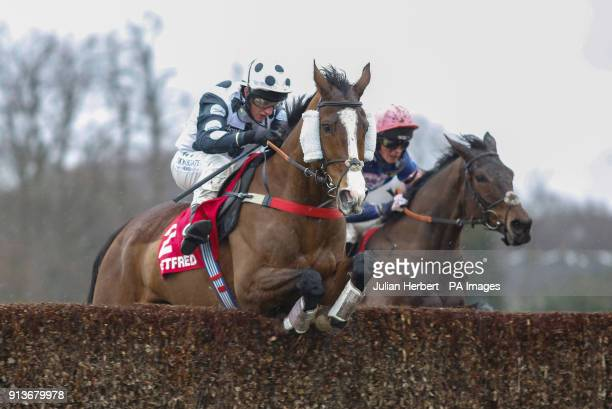 Gino Trail and Jamie Moore clear the last fence in company with Dolos and Harry Cobden before winning The Betfred 'Treble Odds On Lucky 15's'...