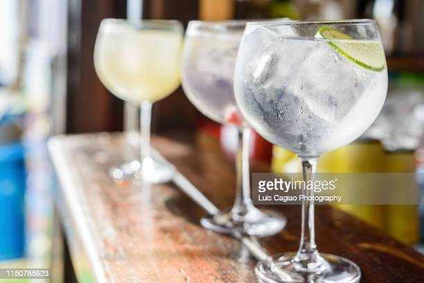 gintonics in a bar - tonic water stock pictures, royalty-free photos & images