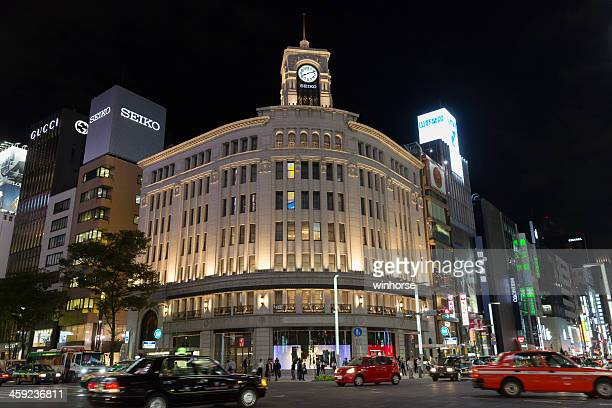 ginza district at night in tokyo, japan - chuo dori street stock photos and pictures