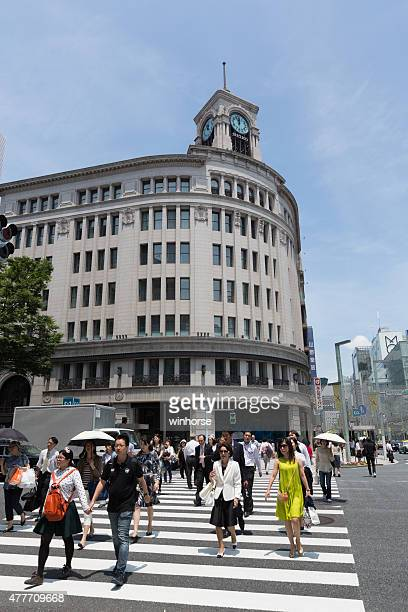 ginza district in tokyo, japan - chuo dori street stock photos and pictures