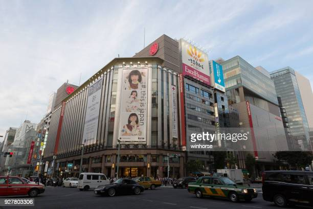 ginza district in tokyo, japan - isetan mitsukoshi holdings stock pictures, royalty-free photos & images