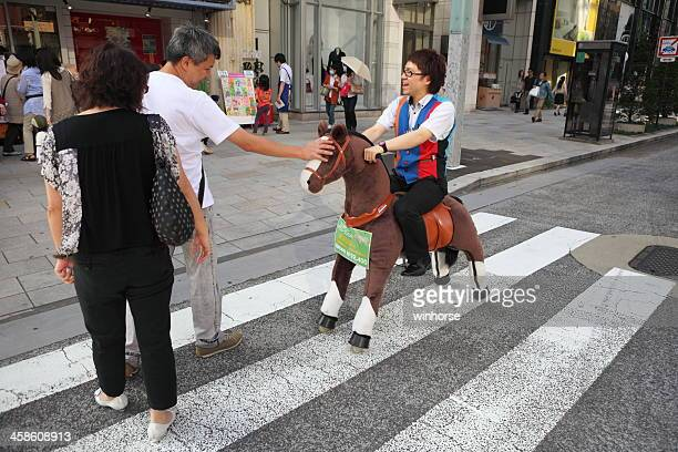 ginza shopping district, japan - chuo dori street stock photos and pictures