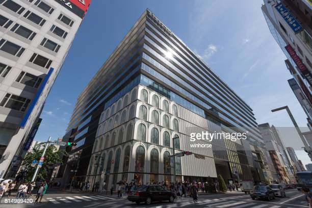 ginza six - largest shopping complex in ginza - chuo dori street stock photos and pictures