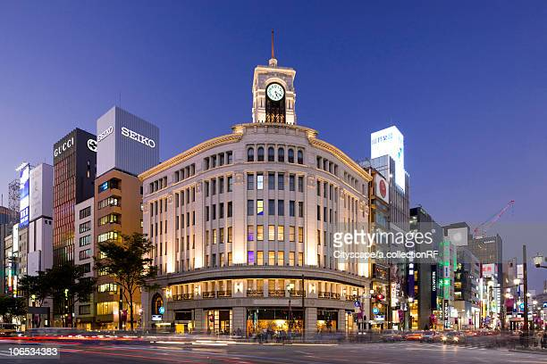 ginza yon-chome crossing, chuo ward at dusk, tokyo prefecture, honshu, japan - ginza stock pictures, royalty-free photos & images