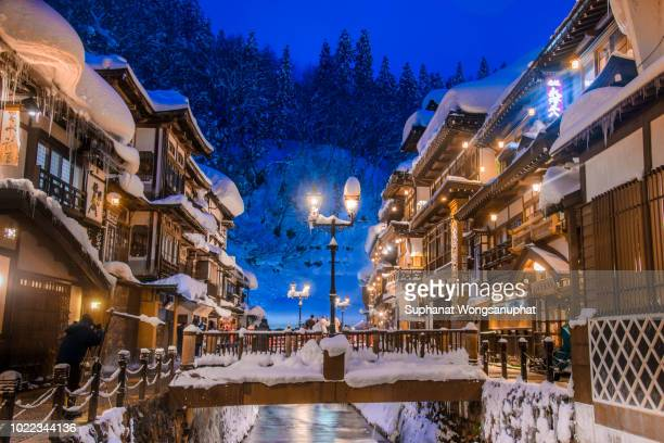 ginzan onsen during winter - hot spring stock pictures, royalty-free photos & images