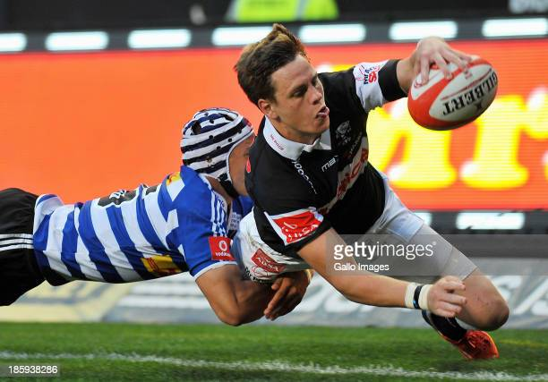 Gio Aplon of Western Province makes a try saving tackle on SP Marais of The Sharks during the Absa Currie Cup final match between DHL Western...