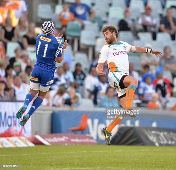 Gio Aplon with the ball and Willie le Roux on the right during the Super Rugby match between Toyota Cheetahs and DHL Stormers at Free State Stadium...