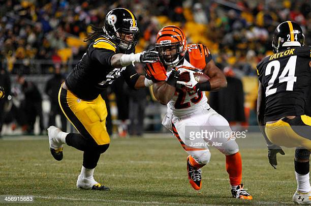 Gio Bernard of the Cincinnati Bengals rushes against Jarvis Jones of the Pittsburgh Steelers during the game on December 15 2013 at Heinz Field in...