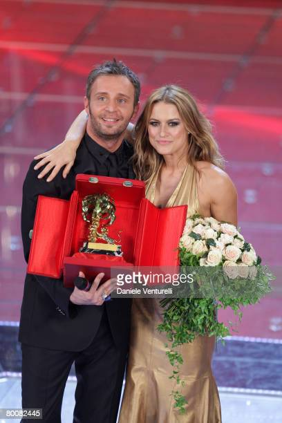 Gio' Di Tonno and Lola Ponce show their trophy after winning the first prize award during the 58th San Remo Music Festival on March 1 2008 in San...