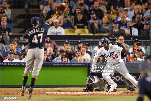 Gio Gonzalez of the Milwaukee Brewers reaches for a ball hit by Yasiel Puig of the Los Angeles Dodgers during the second inning in Game Four of the...