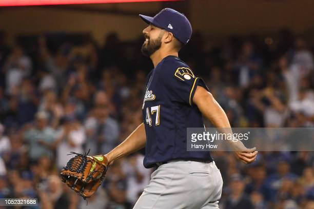 Gio Gonzalez of the Milwaukee Brewers reacts after making a play on a ball hit by Yasiel Puig of the Los Angeles Dodgers during the second inning in...