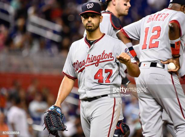 Gio Gonzalez of the Washington Nationals points to Dee Gordon of the Miami Marlins at first base after giving up a no hitter in the ninth inning...