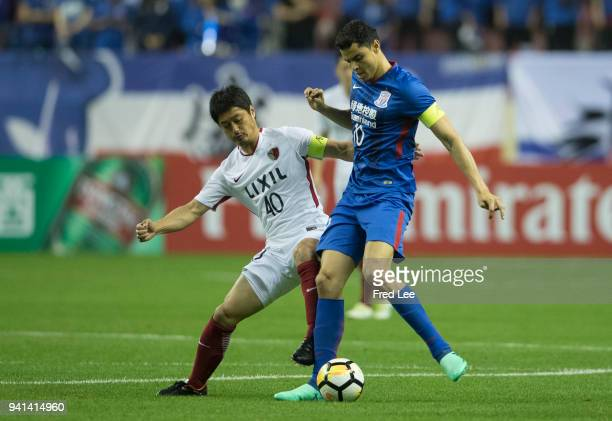 Gio of Shanghai Shenhua FC in action with Mitsuo Ogasawara of Kashima Antlers during the 2018 AFC Champions League match between Shanghai Shenhua and...
