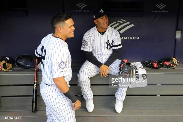Gio Urshela and Gleyber Torres of the New York Yankees joke around in the dugout prior to the game between the Boston Red Sox and the New York...