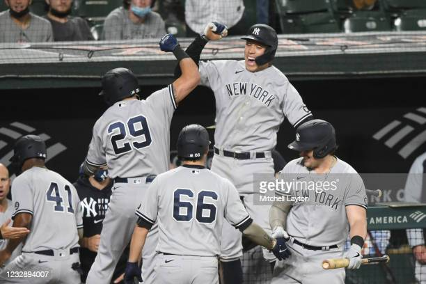Gio Urshela of the New York Yankees celebrates a pinch hit three run home run in the seventh inning with Aaron Judge during a baseball game against...