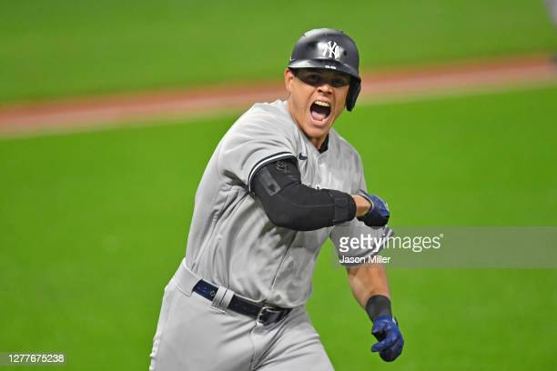 Gio Urshela of the New York Yankees celebrates after hitting a grand slam during the fourth inning of Game Two of the American League Wild Card...