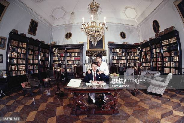 Gioacchino Lanza Tomasi di Lampedusa Duke of Palma and his wife Nicoletta pose in the library of their palace in Palermo Sicily Italy in October 1984...