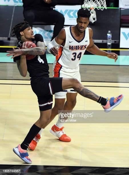 Giordan Williams of the Santa Clara Broncos grabs a rebound against Victor Ohia Obioha of the Pepperdine Waves during the West Coast Conference...