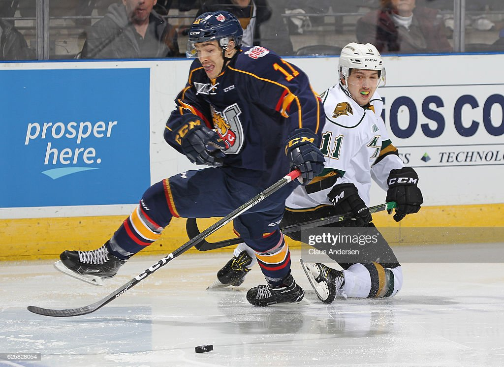 Giordano Finoro #11 of the Barrie Colts skates against Owen MacDonald #11 of the London Knights during an OHL game at Budweiser Gardens on November 25, 2016 in London, Ontario, Canada. The Knights defeated the Colts 4-1.