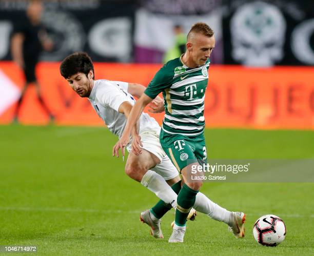 Giorgi Beridze of Ujpest FC competes for the ball with Ivan Petryak of Ferencvarosi TC during the Hungarian OTP Bank Liga match between Ferencvarosi...