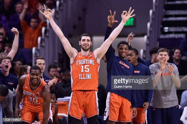 Giorgi Bezhanishvili and the bench of the Illinois Fighting Illini reacts after scoring in the second half against the Northwestern Wildcats at...