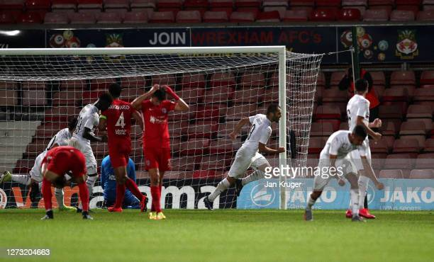 Giorgi Gabedava of FC Dinamo Tblisi turns to celebrate scoring from a penalty during the UEFA Europa League second qualifying round match between...