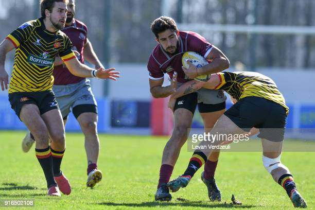 Giorgi Kveseladze of Georgia is tackled during the Rugby Europe Championship round 1 match between Georgia and Belgium at Aia Arena on February 10...