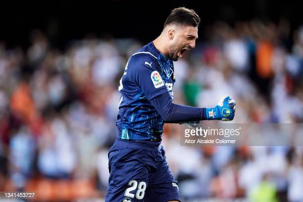 Giorgi Mamardashvili of Valencia celebrates after teammate Hugo Duro scores their side's first goal during the La Liga Santander match between...