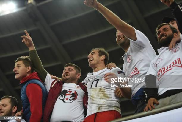 Giorgi Merebashvili of Georgia celebrates with Georgian supporters during the UEFA Nations League D match between Georgia and Kazakhstan at Boris...
