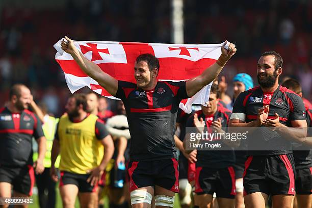 Giorgi Nemsadze of Georgia celebrates with his national flag after his team won the 2015 Rugby World Cup Pool C match between Tonga and Georgia at...