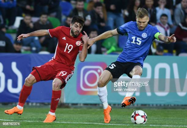 Giorgi Papunashvili of Georgia and Ragnar Klavan of Estonia fight for the ball during international friendly match between Georgia and Estonia at...