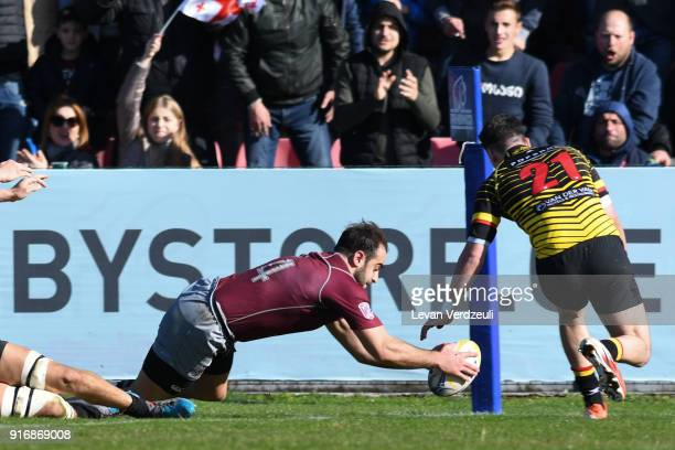 Giorgi Pruidze of Georgia tries during the Rugby Europe Championship round 1 match between Georgia and Belgium at Aia Arena on February 10 2018 in...