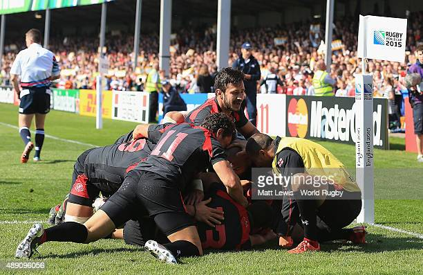 Giorgi Tkhilaishvili of Georgia is congratulated on his try during the 2015 Rugby World Cup Pool C match between Tonga and Georgia at Kingsholm...