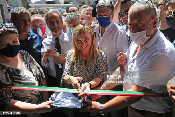 Giorgia Meloni, leader of the Fratelli D'Italia political party, cuts the ribbon to inaugurate the new party headquarters in Naples.