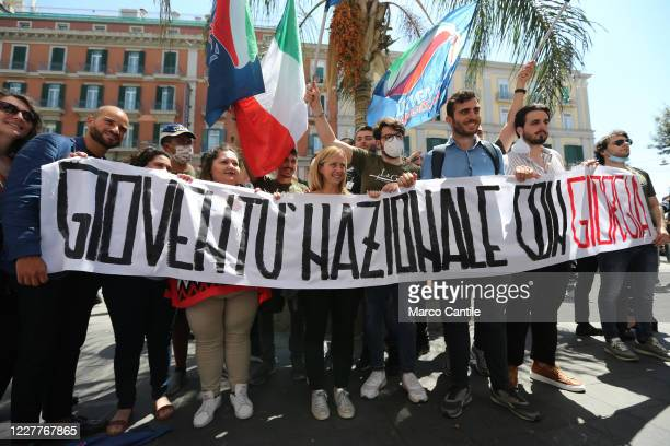 Giorgia Meloni leader of the Fratelli D'Italia political party poses for a photo with the national youth supporters of the party after the press...