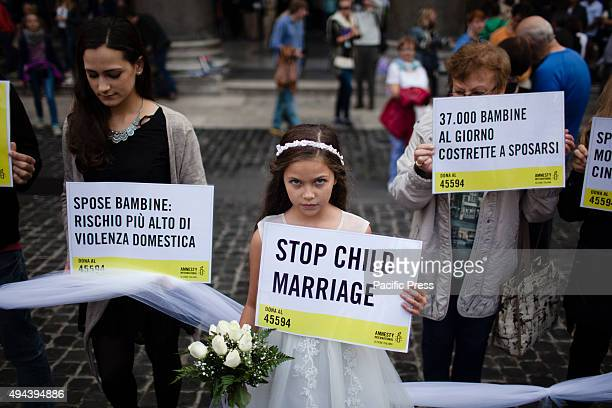 Giorgia ten years old performing a fake child marriage organized by Amnesty International in front of Pantheon in RomeAccording to United Nations...