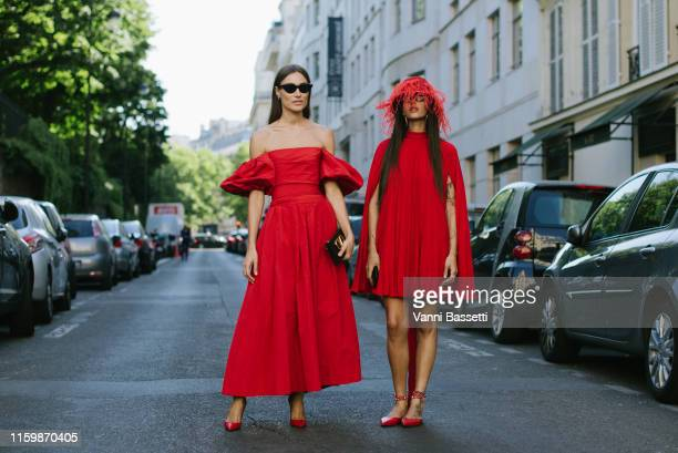 Giorgia Tordini and Gilda Ambrosio pose wearing Valentino after the Valentino Show during Paris Fashion Week Haute Couture Fall/Winter 2019/2020 on...